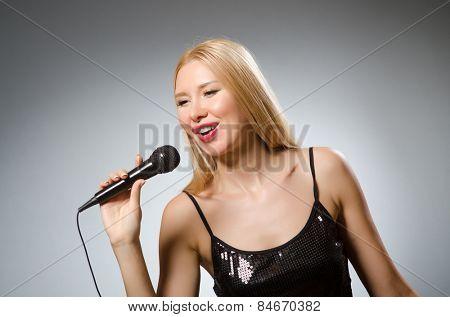 Woman singing in karaoke club