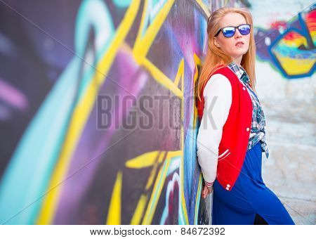 Girl Against Painted Wall