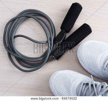 Skipping rope with sport shoes