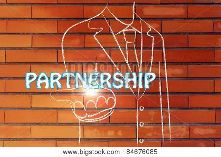 Business Man Handing Out The Word Partnership