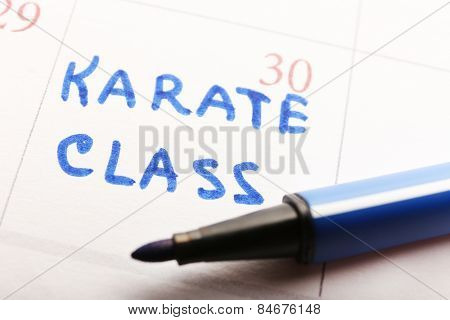 Written plan Karate Class on calendar page background