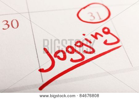 Written plan Jogging on calendar page background