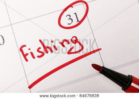 Written plan Fishing on calendar page background