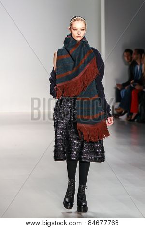 NEW YORK - FEBRUARY 12: A model walks the runway at the Richard Chai Fall/Winter 2015 collection during Mercedes-Benz Fashion Week in New York on February 12, 2015.