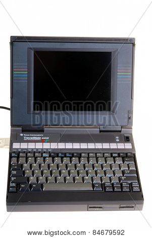 Hayward, CA - February 23, 2015: 23 year old Texas Instruments TravelMate 4000E color laptop computer using Windows 3.1 -Illustrative Editorial
