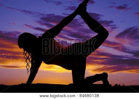 Silhouette Of A Pregnant Woman Stretching