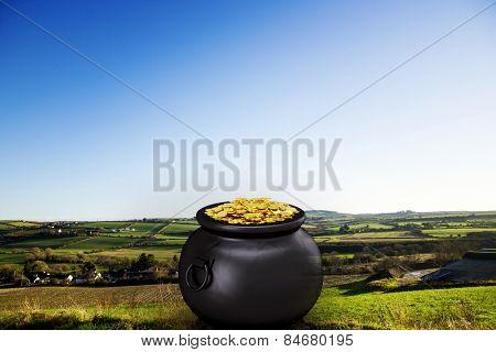 pot of gold against scenic landscape