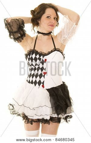 Woman In A Black And White Costume Hands Behind Head