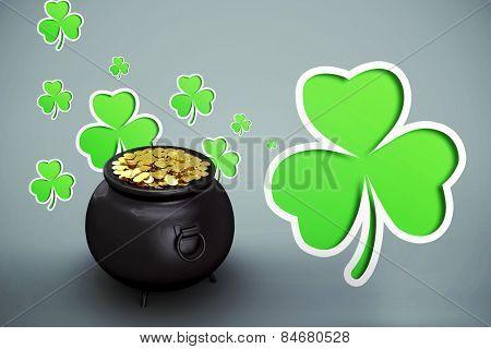 pot of gold against green shamrocks on grey background