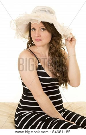 Woman With Long Hair And A Hat Serious Expression