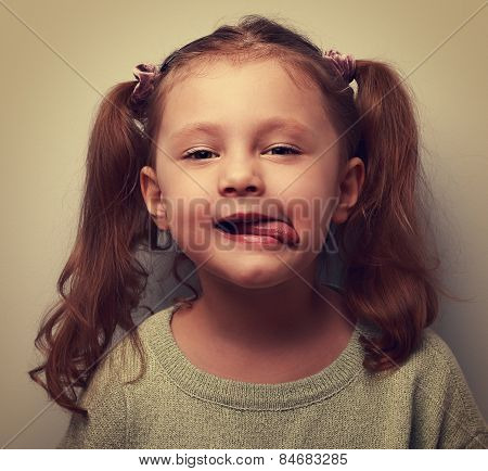 Funny Kid Girl Showing Tongue. Cool Child Joke. Vintage Closeup Portrait