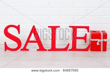 Sale with gift on floor in room