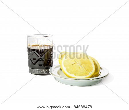 Shot Glass With Alcohol And Lemon On A Saucer