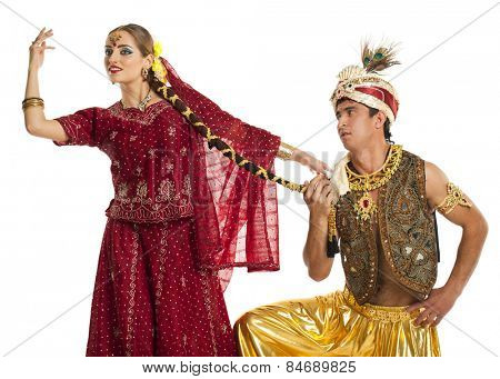 Indian couple. Portrait of beautiful Indian family in traditional costume standing isolated on white background. Indian husband and wife model.