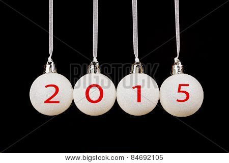 Four hanging white christmas balls with new year 2015