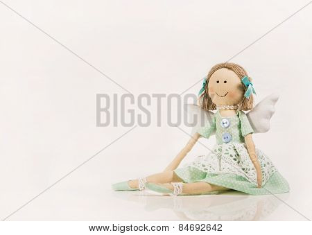 Isolated doll or puppet like a guardian angel.