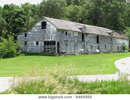 large white dilapidated barn