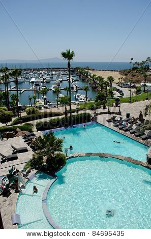ENSENADA, BAJA CALIFORNIA, MEXICO- AUGUST 23, 2015: Resort with swiming pool and a yacht club in a sunny day in Ensenada, Baja California, Mexico