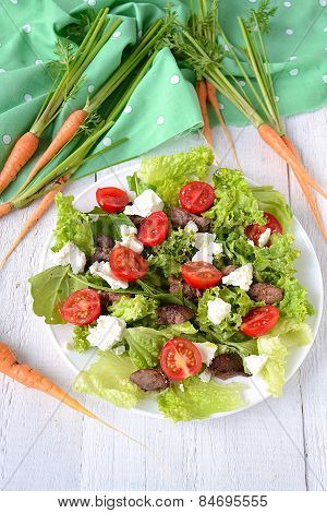 Salad With Chicken Liver. Cherry Tomatoes And Feta Cheese