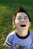 stock photo of happy kids  - A happy kid playing outdoor - JPG