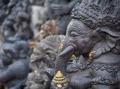 stock photo of hindu temple  - Ancient Balinese statue at the temple in Bali Indonesia - JPG