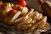 stock photo of greek  - Homemade Greek Easter Bread with Red Eggs - JPG