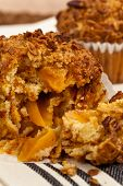stock photo of pecan  - Crunchy Granola Peach Muffins with Butter Pecan Toppings - JPG