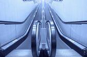 stock photo of escalator  - Empty moving escalator stairs in the supermarket - JPG