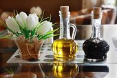 picture of vinegar  - Bottles of olive oil and vinegar on a table in a cafe - JPG