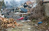 image of abandoned house  - Debris in town abandoned house ruins and garbage - JPG
