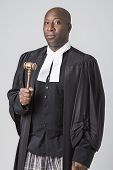picture of toga  - forty something bald african american wearing a canadian lawyer toga holding a gavel - JPG