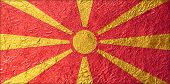 foto of macedonia  - Macedonia Flag with a Shiny leaf Bronze Shiny leaf foil texture background - JPG