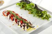 Постер, плакат: Caprese Salad Salad with Tomatoes Mozzarella Cheese Balsamic Salad Dressing with Pesto Sauce an