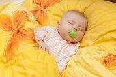 picture of teats  - sleeping baby girl in big bed - JPG