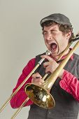 image of trombone  - Jazz musician has had enough of his rusty trombone
