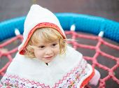 picture of hoodie  - Beautiful little girl with hoodie playing in the playground - JPG