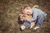 picture of instagram  - Young boy hugging his cat - JPG