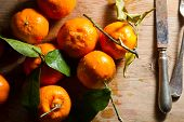 pic of clementine-orange  - Juicy fresh clementines against a wooden background - JPG