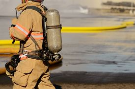 picture of firefighter  - Firefighters on using large volume appliance water delivery - JPG