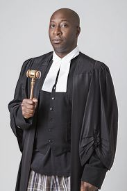 image of toga  - forty something bald african american wearing a canadian lawyer toga holding a gavel - JPG