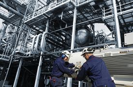 stock photo of refinery  - oil and gas workers inside refinery - JPG