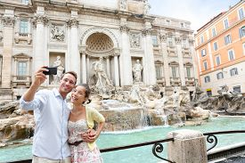 picture of selfie  - Tourist couple on travel taking selfie photo by Trevi Fountain in Rome - JPG
