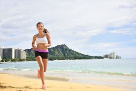 foto of jogger  - Sport running fitness woman jogging on beach run - JPG