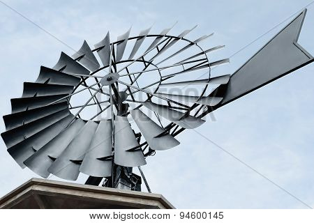 Close up of a of a water pumping windmill.