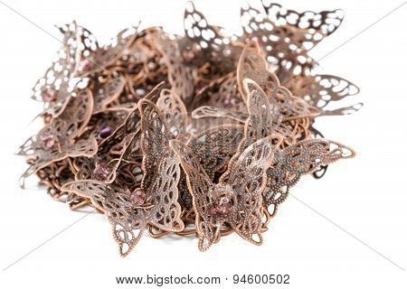Pile of metal butterflies