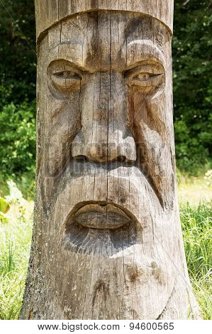 Vintage face carved in wood