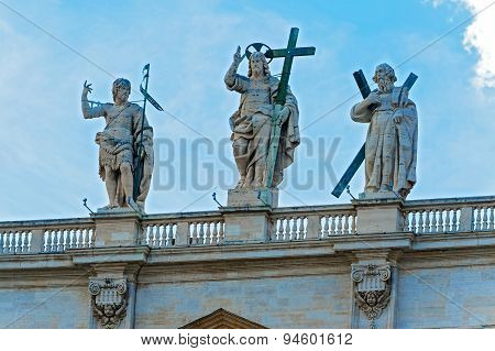 Statues Above St. Peter Basilica In Rome.