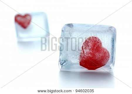 Red hearts in ice cubes isolated on white