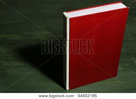 Textbook on wooden background