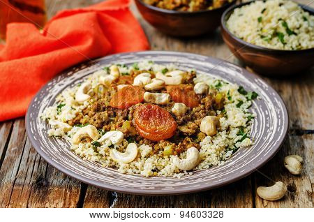 Spiced Mince With Dried Apricots, Cashew Nuts And Couscous. Moroccan Dish